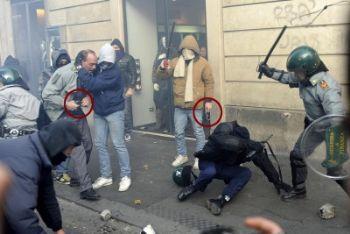 L'agente provocatore (con la giacca beige)