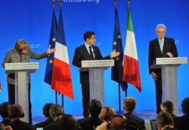 Angela Merkel, Nicolas Sarkozy e Mario Monti (Foto Ansa)
