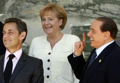 Nicolas Sarkozy, Angela Merkel e Silvio Berlusconi (Foto Ansa)