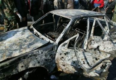 Una delle due autobombe esplose ieri a Damasco (Ansa)