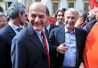 Pier Luigi Bersani e Giuliano Pisapia a Milano (Imagoeconomica)