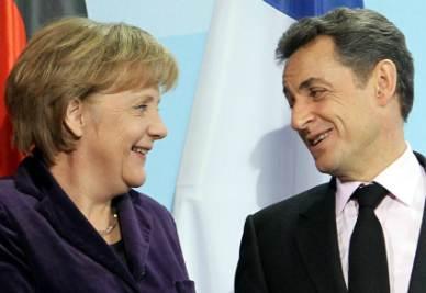 Angela Merkel e Nicolas Sarkozy (Infophoto)