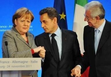 Angela Merkel, Nicolas Sarkozy e Mario Monti (InfoPhoto)