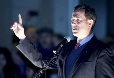 U.S. ELECTIONS/ Catholic presidential candidates: JFK vs Santorum