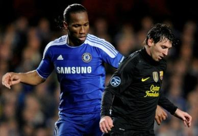 Didier Drogba e Lionel Messi (Infophoto)