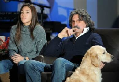 Il padre di Simoncelli con Kate Fretti, foto InfoPhoto