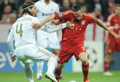 Ramos e Ribery nella gara d'andata (INFOPHOTO)