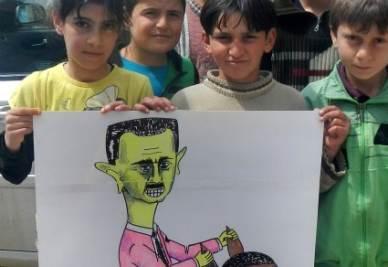 Bambini siriani con una caricatura di Assad
