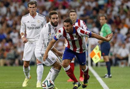 Koke sfugge a Carvajal nel corso della partita di andata