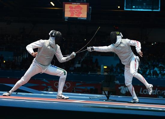Andrea Cassarà - a sinistra - in azione (Infophoto)
