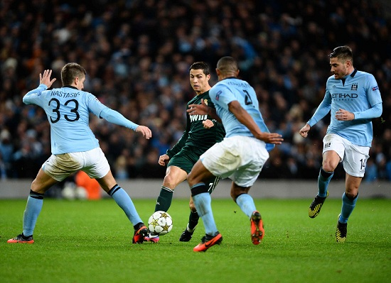 Il Manchester City in Champions League (Infophoto)