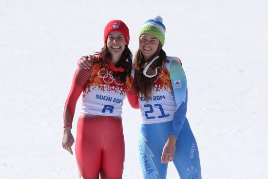 Dominique Gisin (a sinistra) a Sochi 2014, con Tina Maze (Infophoto)