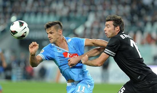 Maggio contro Barzagli lo scorso anno (Infophoto)