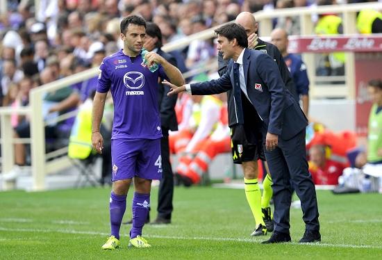 Giuseppe Rossi a colloquio con Vincenzo Montella (Infophoto)
