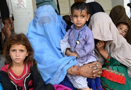 Famiglia afghana (Infophoto)