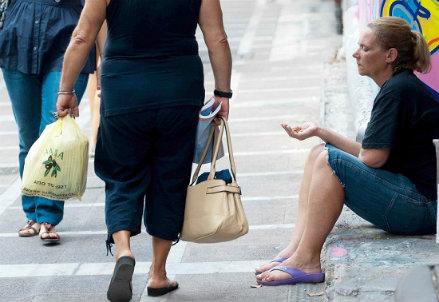 I poveri sono in aumento (InfoPhoto)
