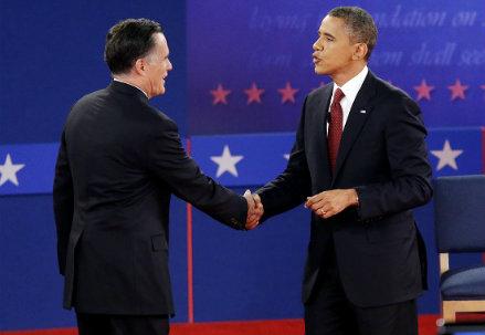 Barack Obama e Mitt Romney (Infophoto)