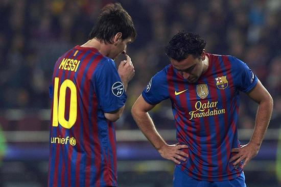 Messi e Xavi (Infophoto)