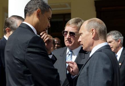Barack Obama (S) e Vladimir Putin (Infophoto)