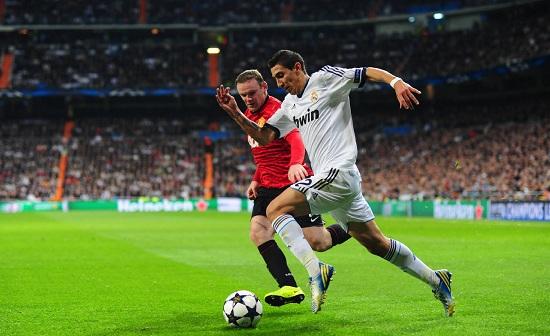 Rooney e Di Maria nella partita d'andata (Infophoto)