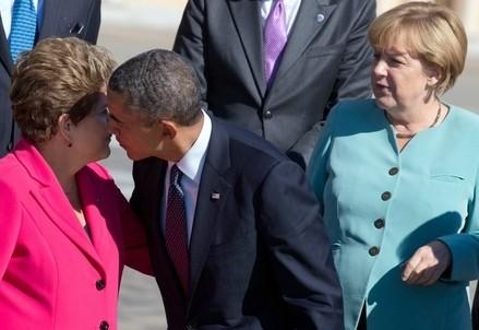 Dilma Rousseff (S) con Barack Obama e Angela Merkel (Infophoto)