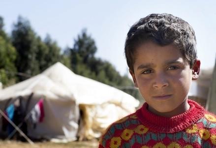 Un piccolo rifugiato siriano in Libano (Infophoto)