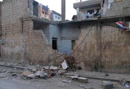 Distruzioni nell'abitato di Homs dopo gli scontri tra lealisti e ribelli