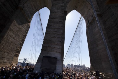 The crowd passing over the bridge