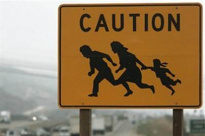 Immigrant Crossing sign