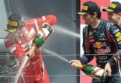 Fernando Alonso e Mark Webber scattano dalla prima fila (Infophoto)