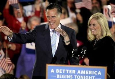 Mitt and Ann Romney campaigning   (Infophoto)