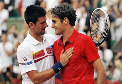 Novak Djokovic e Roger Federer (Infophoto)