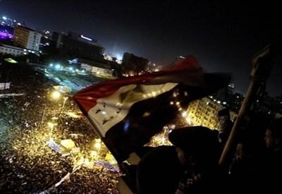 I festaggiamenti per l'anniversario della rivolta di piazza Tahrir (Infophoto)