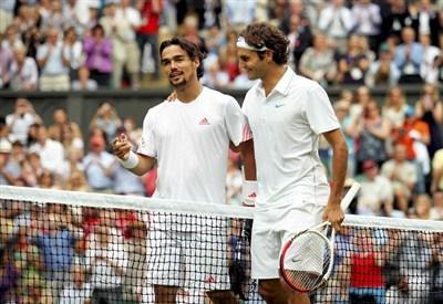 Fabio Fognini e Roger Federer (Infophoto)