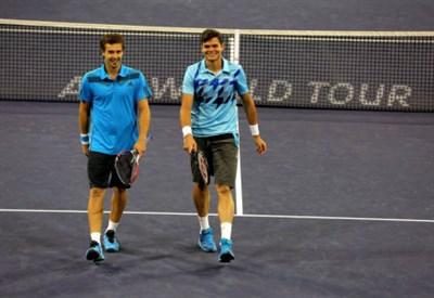 Ernests Gulbis (25) e Milos Raonic (23): hanno giocato insieme in doppio a Indian Wells