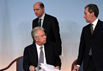 Mario Monti, Corrado Passera e Vittorio Grilli (Infophoto)