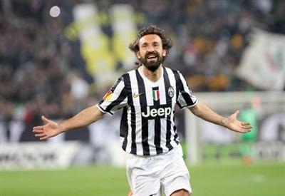 Andrea Pirlo esulta per il gol contro il Lione nei quarti (Infophoto)