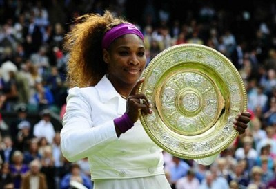 Serena Williams with her Wimbledon trophy   (Infophoto)