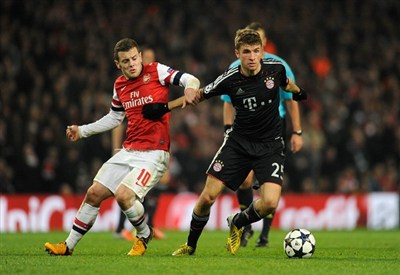 Jack Wilshere contro Thomas Muller (Infophoto)
