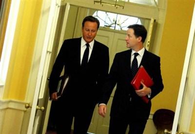 David Cameron e Nick Clegg a Downing Street (Infophoto)