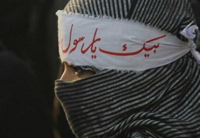Una donna con il burqa (Foto: Lapresse)
