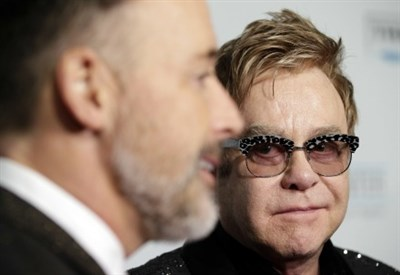 David Furnish e Elton John (Infophoto)