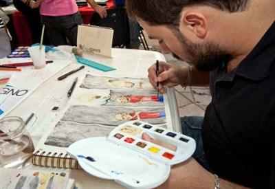 Un fumettista al lavoro (InfoPhoto)