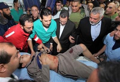 Un bambino ferito a Gaza (InfoPhoto)