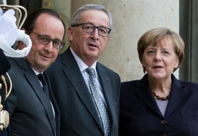 Hollande, Juncker e Merkel (Infophoto)