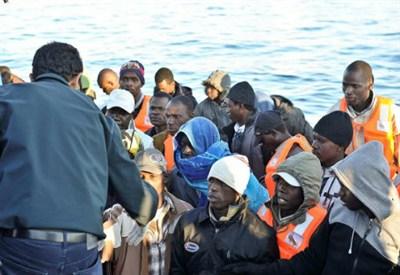Migranti (Fonte Infophoto)