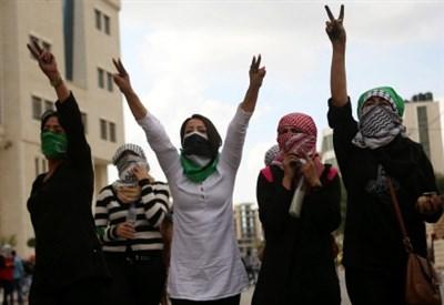 Ragazze palestinesi a Ramallah (Infophoto)