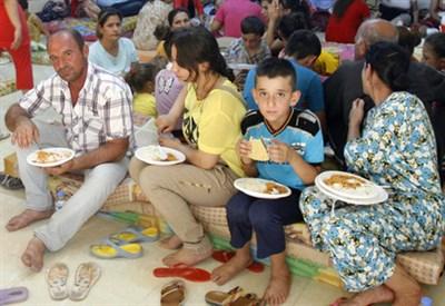 Profughi in Iraq (Infophoto)