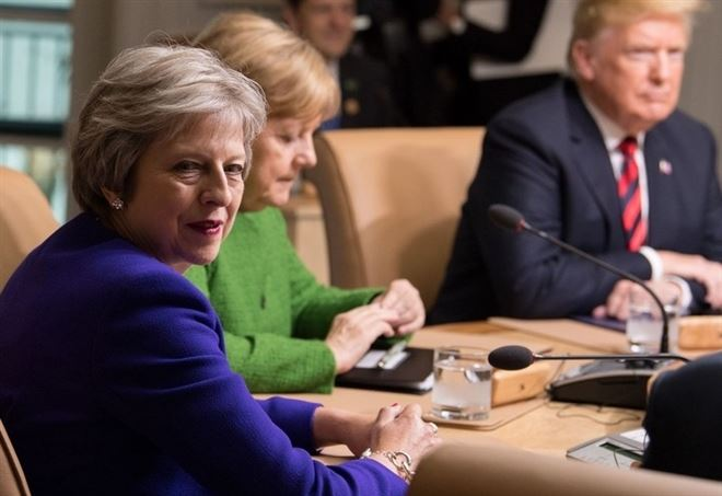 Theresa May, Angela Merkel e Donald Trump al G7 di Charlevoix (LaPresse)