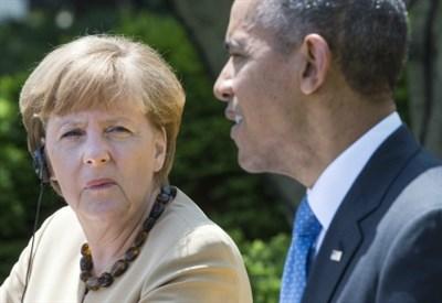 Barack Obama con Angela Merkel (Infophoto)